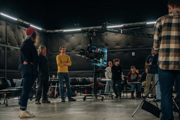 Motion pictures students gather around camera