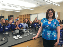Garrett and DCA students pose for photo in science lab