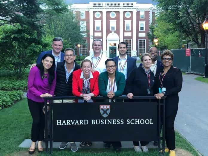 Group Photo in front of Harvard Business School Sign