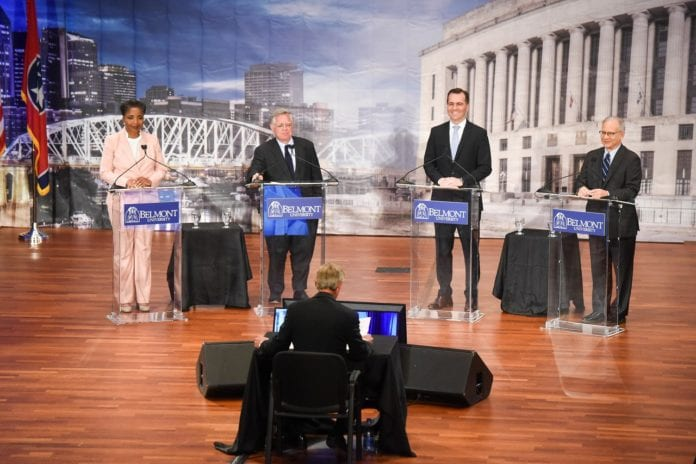 Mayor David Briley, At-Large Councilman John Cooper and former Vanderbilt professor- turned-national television analyst Carol Swain and Rep. John Ray Clemmons speak in a Nashville Mayoral debate in the McAfee Concert Hall on the campus of Belmont University in Nashville, Tennessee, July 9, 2019.
