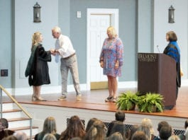 Dr. Mills Accepts Scholarship