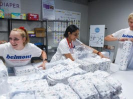 Student packaging diapers for Nashville Diaper Connection as part of annual day of service.