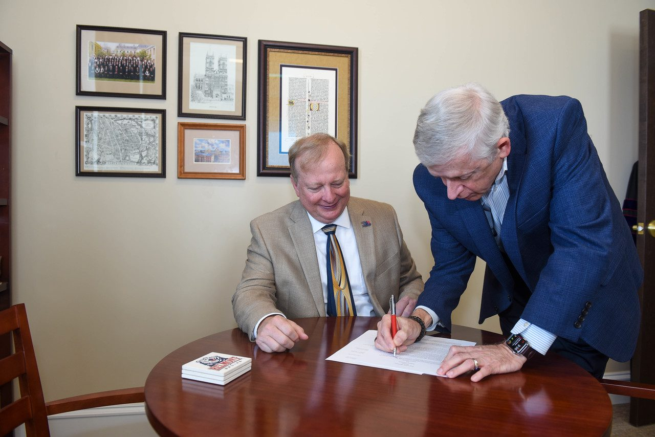 Stone and Gwaltney sign the Transition Agreement