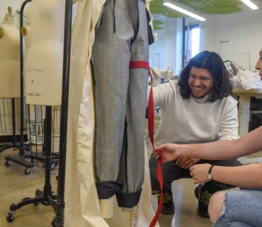 Justice Ybarra Works on Measurements for Denim Days Project