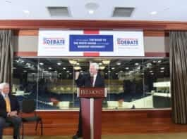 Dr. Bob Fisher announces the debate