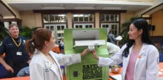 Pharmacy Students Demonstrate Using Safe Drug Deposit Box