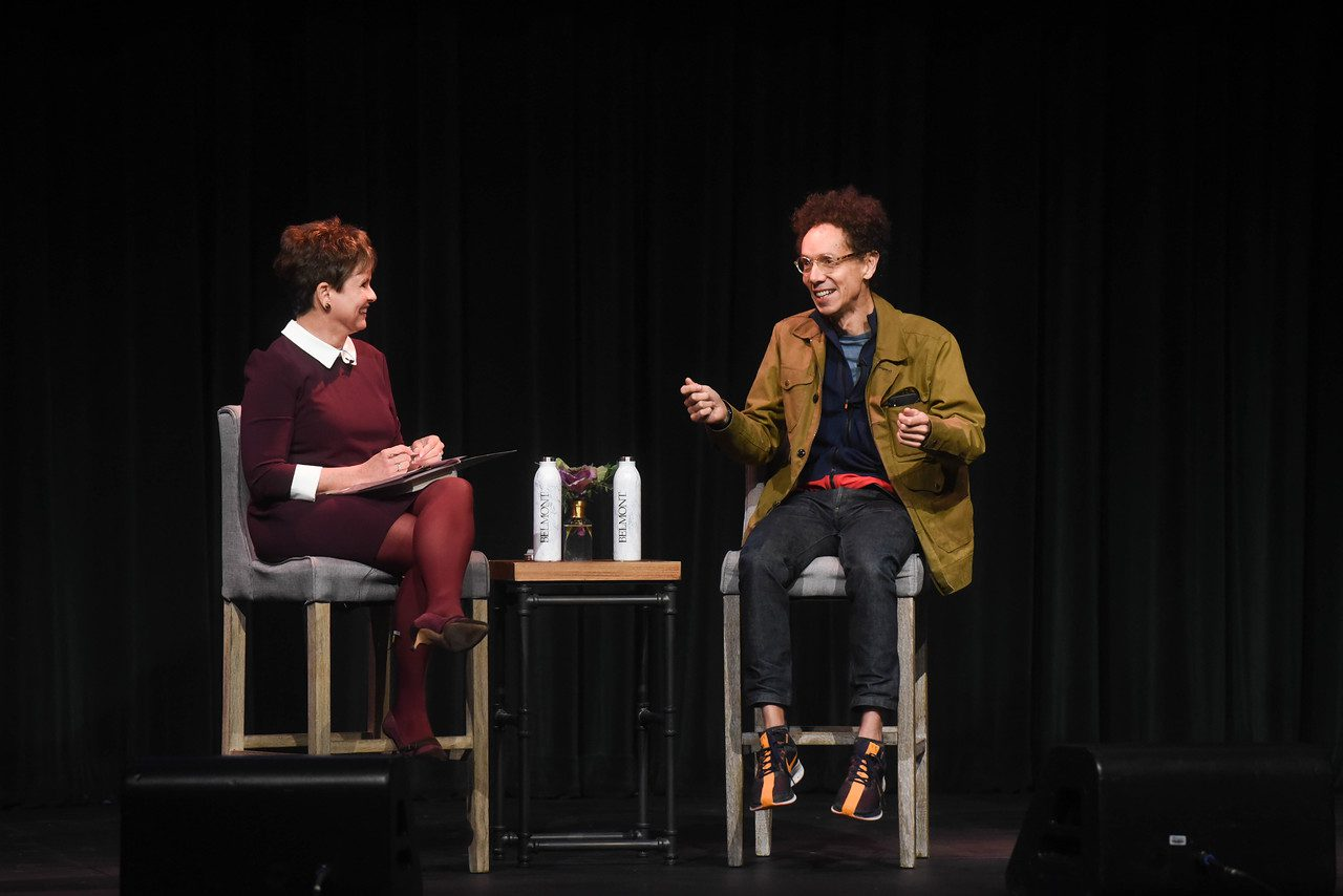 Malcolm Gladwell is interviewed by Demetria Kalodimos at the Fall Leadership Breakfast at Belmont