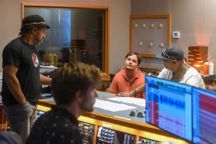 Luke Putney in the studio with Victor Wooten and other artist recording tracks for his latest song