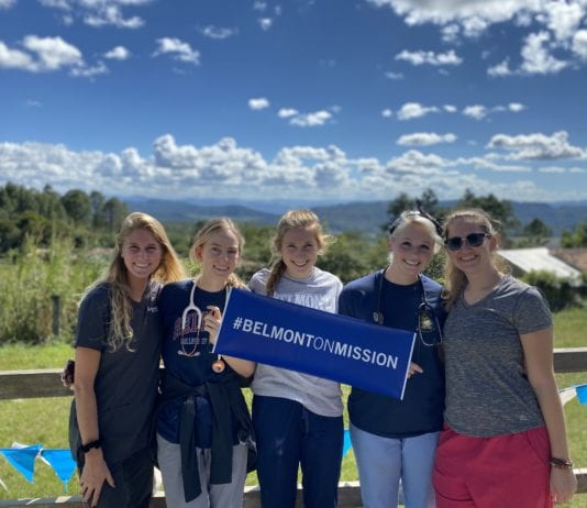 Belmont students hold mission sign in Honduras