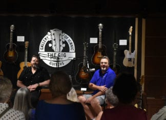 "Vince Gill and Chris Young recording an episode of the ""Country Mile"" podcast in the Gallery of Iconic Guitars at Belmont University in Nashville, Tennessee, September 4, 2019."