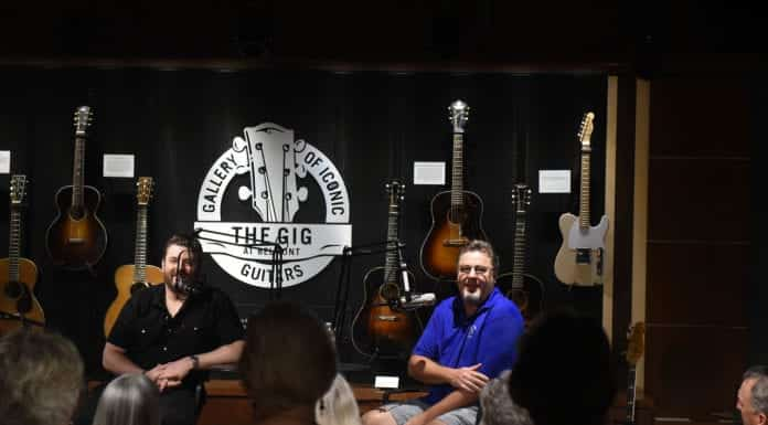 """Vince Gill and Chris Young recording an episode of the """"Country Mile"""" podcast in the Gallery of Iconic Guitars at Belmont University in Nashville, Tennessee, September 4, 2019."""