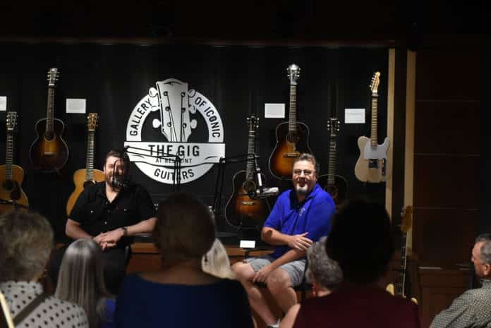 Vince Gill and Chris Young recording an episode of the
