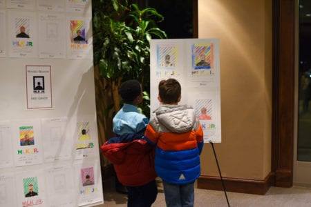 Two Boys Look at Essay Exhibit