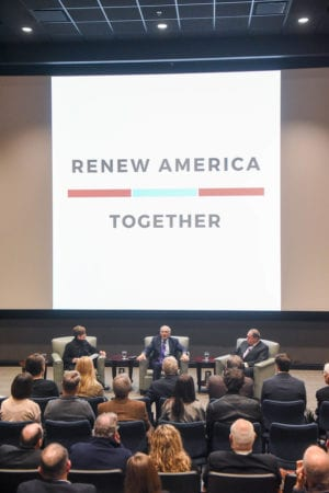 Renew America Together Sign Behind Panel