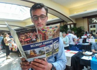 Student reads brochure at the Belmont Abroad Fair