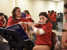 Belmont student teaches young adult the flute