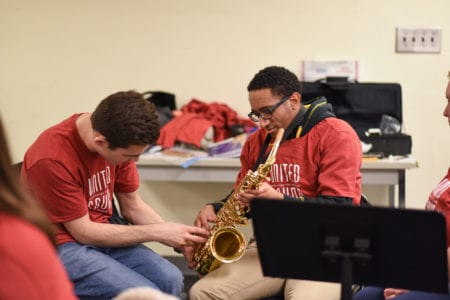 United Sound student receives lesson on saxophone