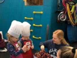 "OT students and cooking school friends making ""caterpillars"" with grapes and tomatoes."