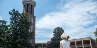 Woman looks up at Bell Tower