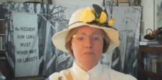 woman in hat with yellow roses