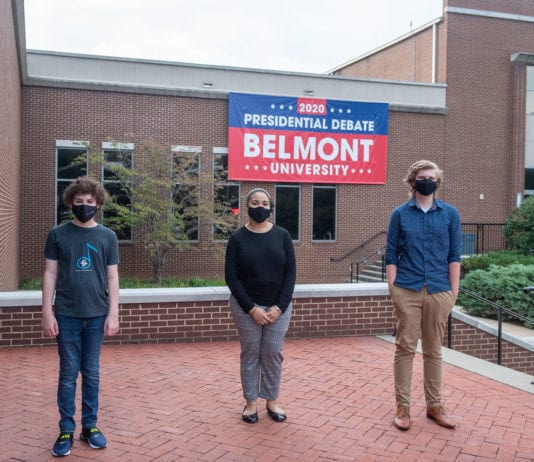 Essay Winners Pose in front of Debate banner on Belmont's campus