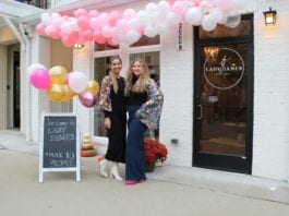 Emily James and sister in front of store