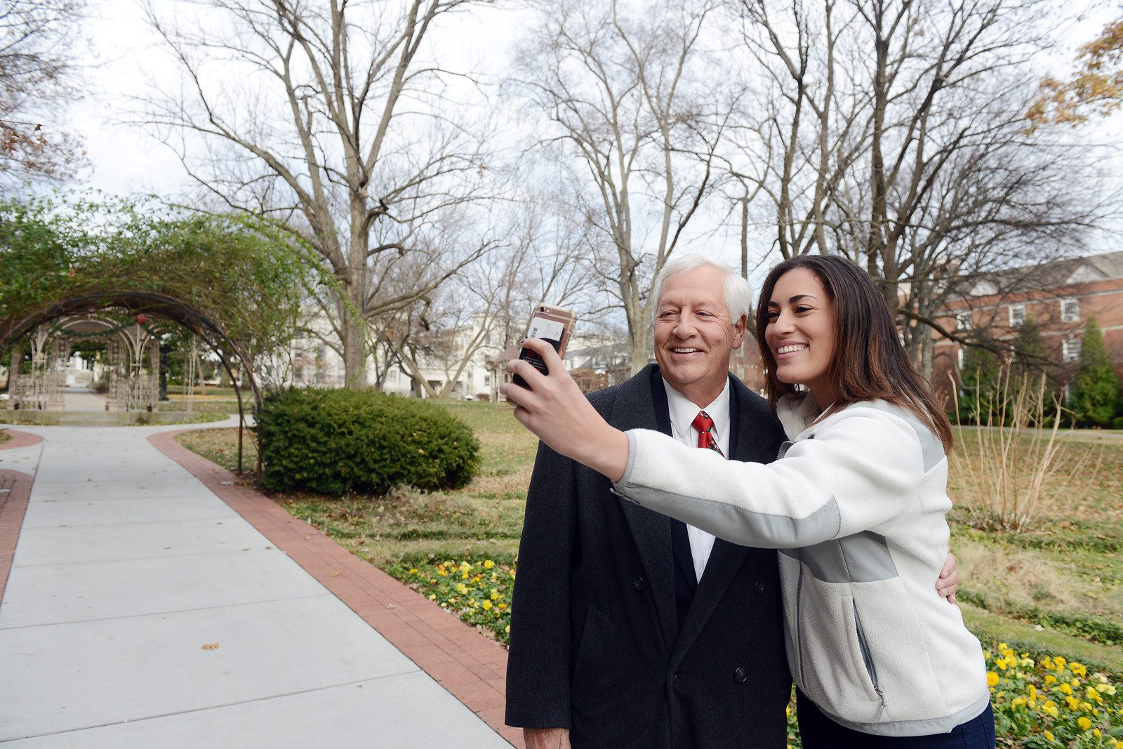 Student takes a selfie with Dr. Fisher
