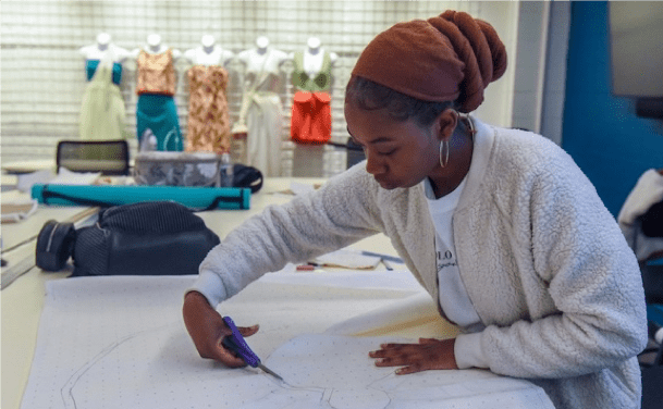 O'More fashion student working on a project