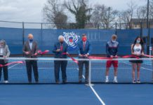 Pat Johnson, Bill DeLoache, Dr. Fisher, Scott Corley, Marko Illic, Somer Henry and Mauricio Antun cut the ribbon during the ceremony opening Belmont's new rooftop tennis facility at Belmont University in Nashville, Tennessee, March 10, 2021. rrThe court are on top of a parking garage and directly next to the new Athletic facility that will be opening soon.