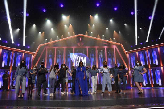 Guyton and Belmont students and alumni on stage