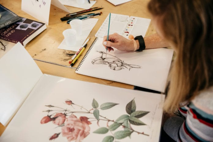 A student paints at Watkins College of Art at Belmont.