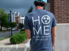 """Student wearing T-shirt during Move In that says 'HOME - Belmont University Residence Life"""""""