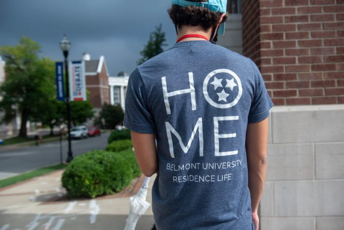 Student wearing T-shirt during Move In that says 'HOME - Belmont University Residence Life