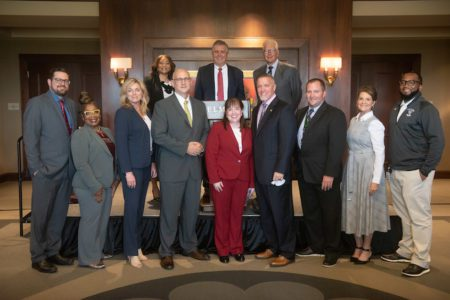 Dr. Adrienne Battle, Dr. Greg Jones and Milton Johnson pose with Metro High School Principals after Belmont announced a significant expansion to its Bridges to Belmont program.