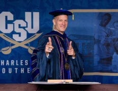 President Dondi Costin in regalia giving a double thumbs up towards the camera.