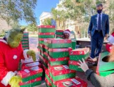 President Dondi Costin assists with transporting donated Operation Christmas Child shoeboxes at Charleston Southern University