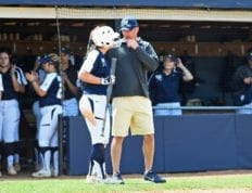 Softball coach Shane Winkler coaches a player
