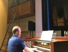 Matthew Swingle plays the organ in Lightsey Chapel to test the pipes.