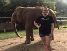 Deanna Yates smiles in front of elephant