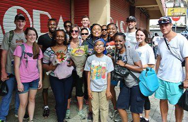 A group of students on a mission trip in the caribbean.