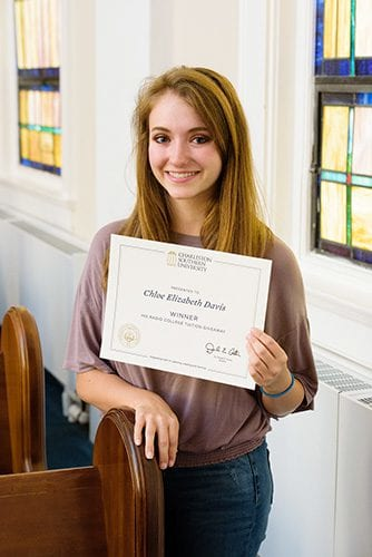 Winner of the His Radio Tuition Giveaway contest, Chloe Davis, holding her certificate.