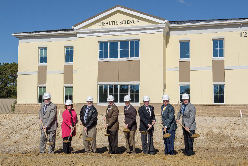 CSU board of trustees in front of health science building. Charleston Southern breaks ground on new physical therapy wing.