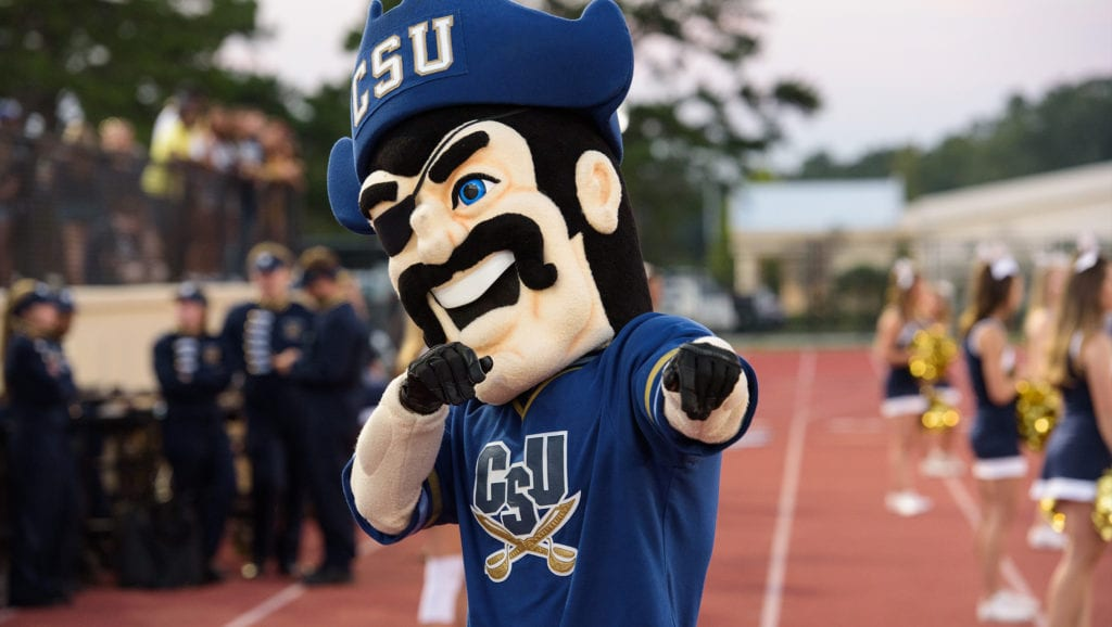 CSU's mascot Bucky pointing at the camera on the sidelines of a football game.