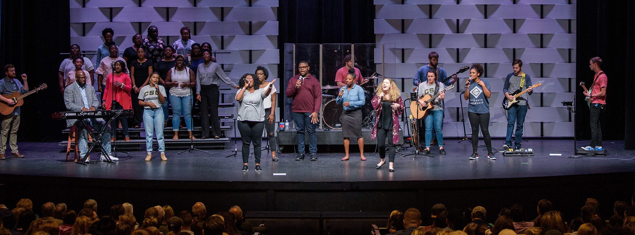 A full stage of singers and musicians during CSU's gospel chapel.