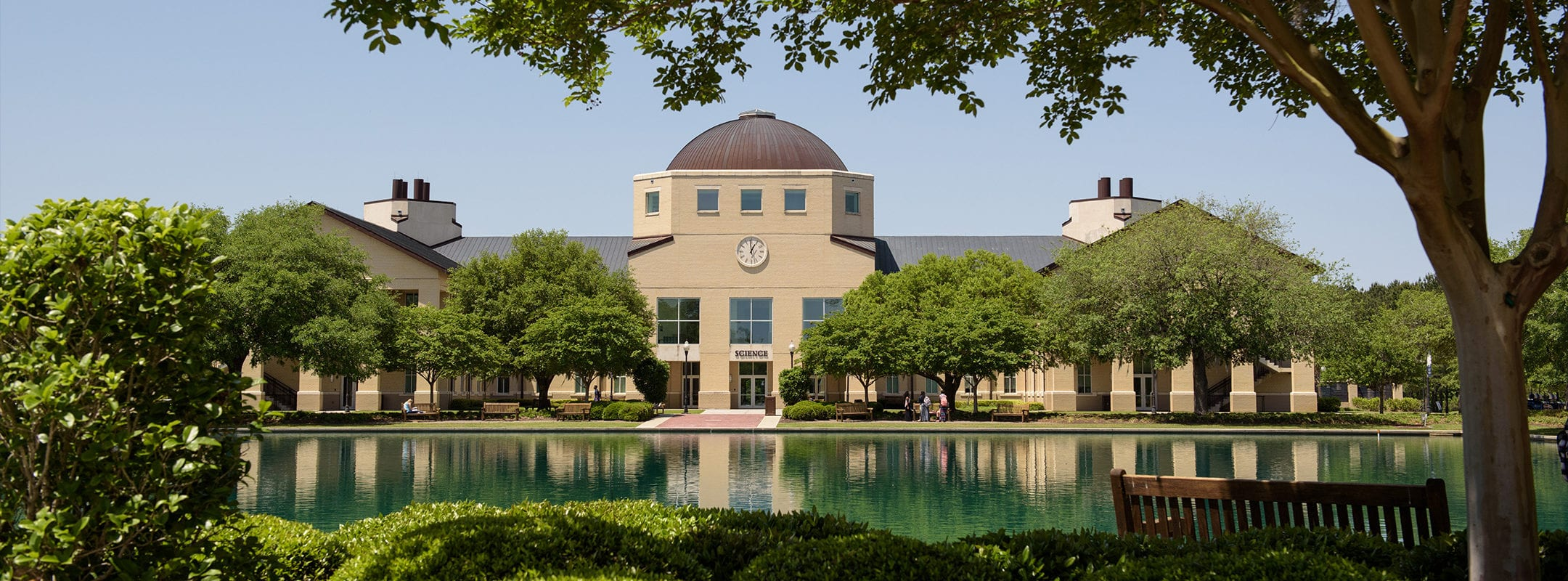 Charleston Southern University's Science building with the reflection pond on a sunny day