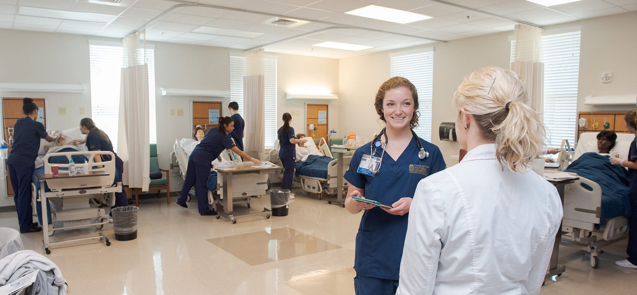 A CSU nursing student talking with a professor in the skills lab at the College of Nursing.