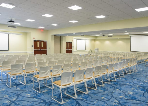 CSU event space Whitfield Center Drew Conference Room with chairs and projection screens setup.