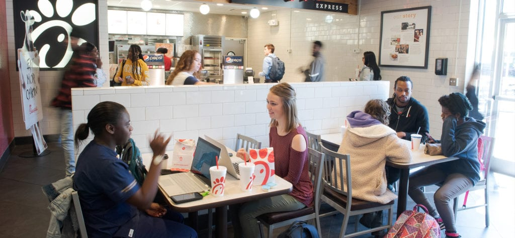 Students eating lunch in Chick-Fil-A Express on campus.