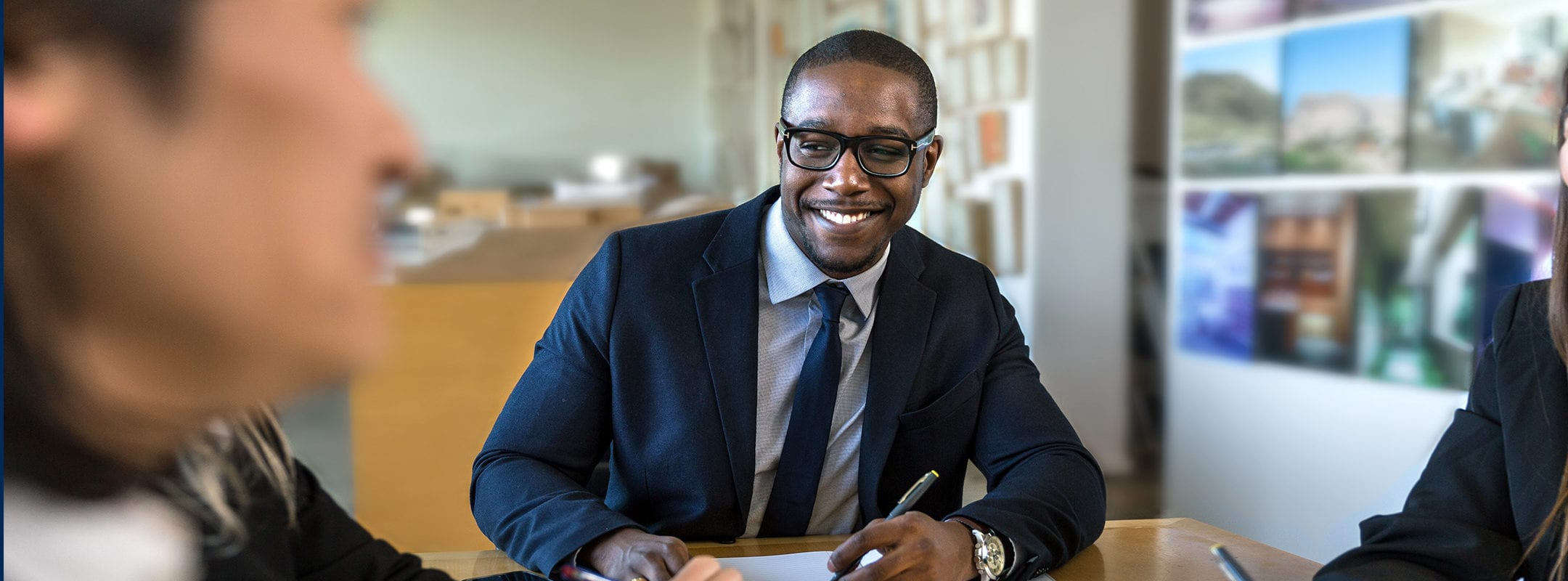 African american executive business man at group table meeting
