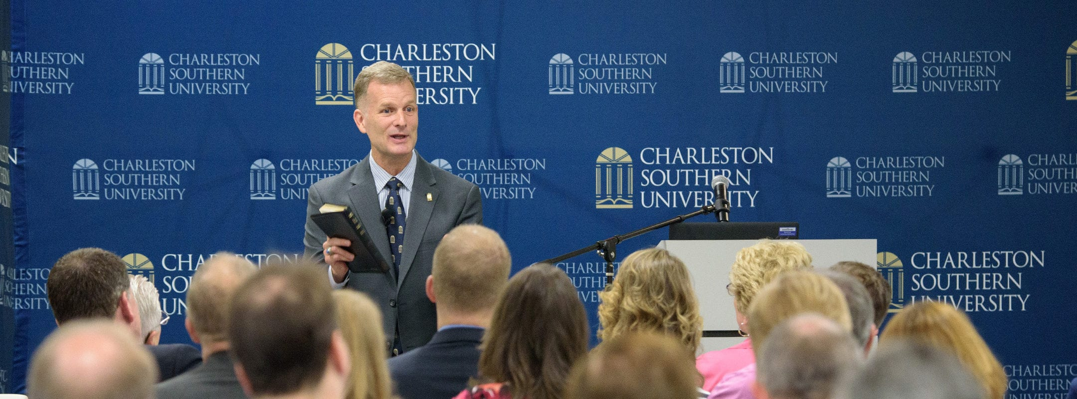 President Costin speaks to a crowd at a Board of Visitors meeting.